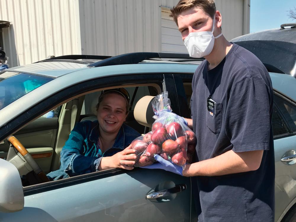 Agency Volunteer Distributing Food