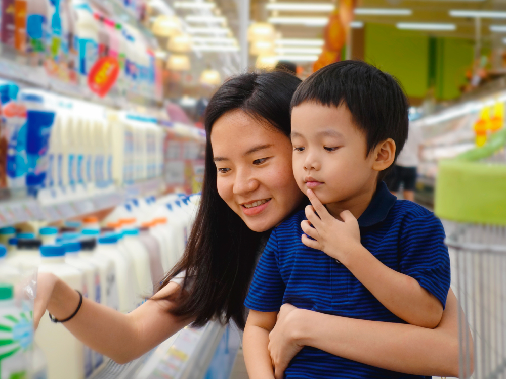 Mother and Son Getting Milk in Store