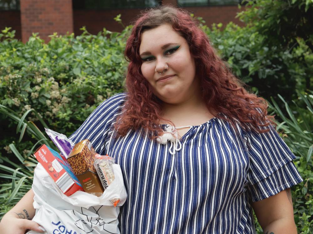 Woman Holding Bag of Food