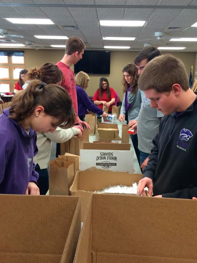 Volunteers Preparing Give Lunch Bags