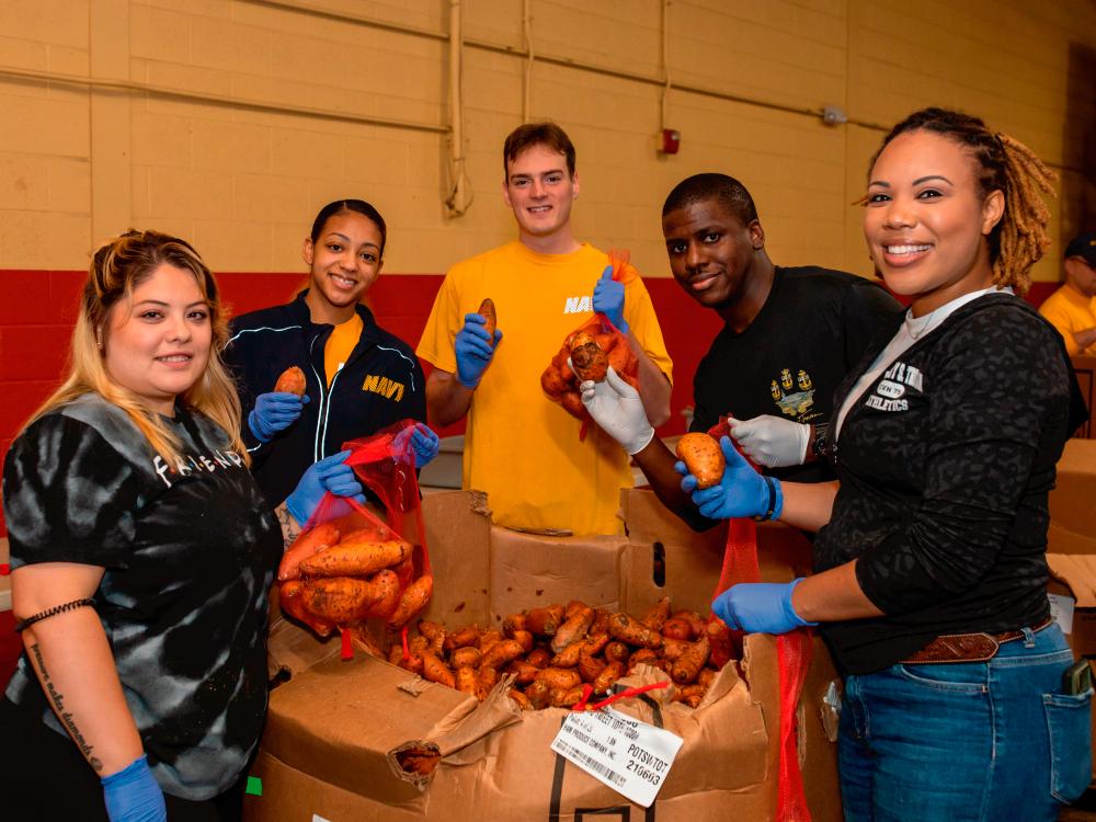 Group of Volunteers Sorting Produce