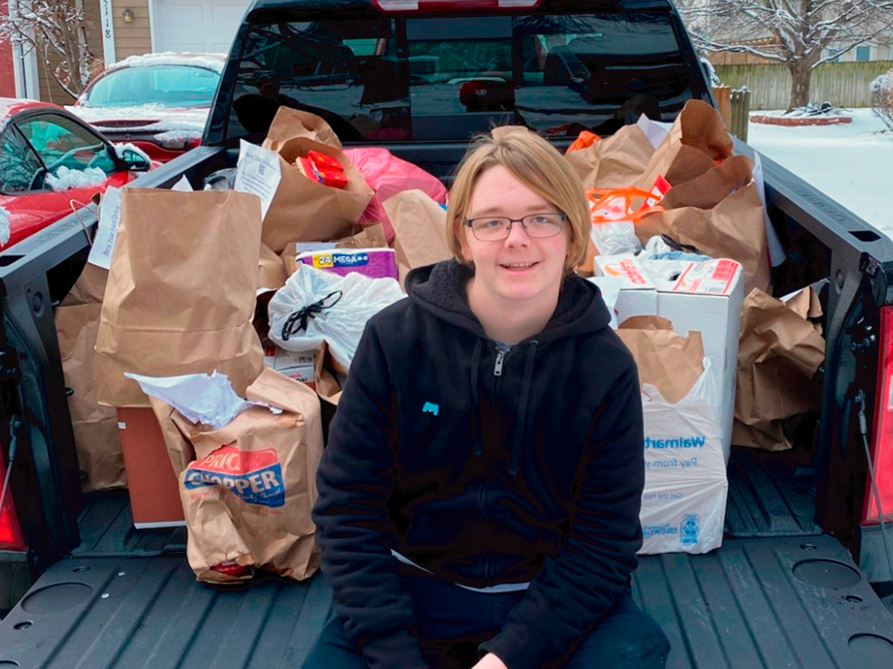 Young Man with Donation in Truck