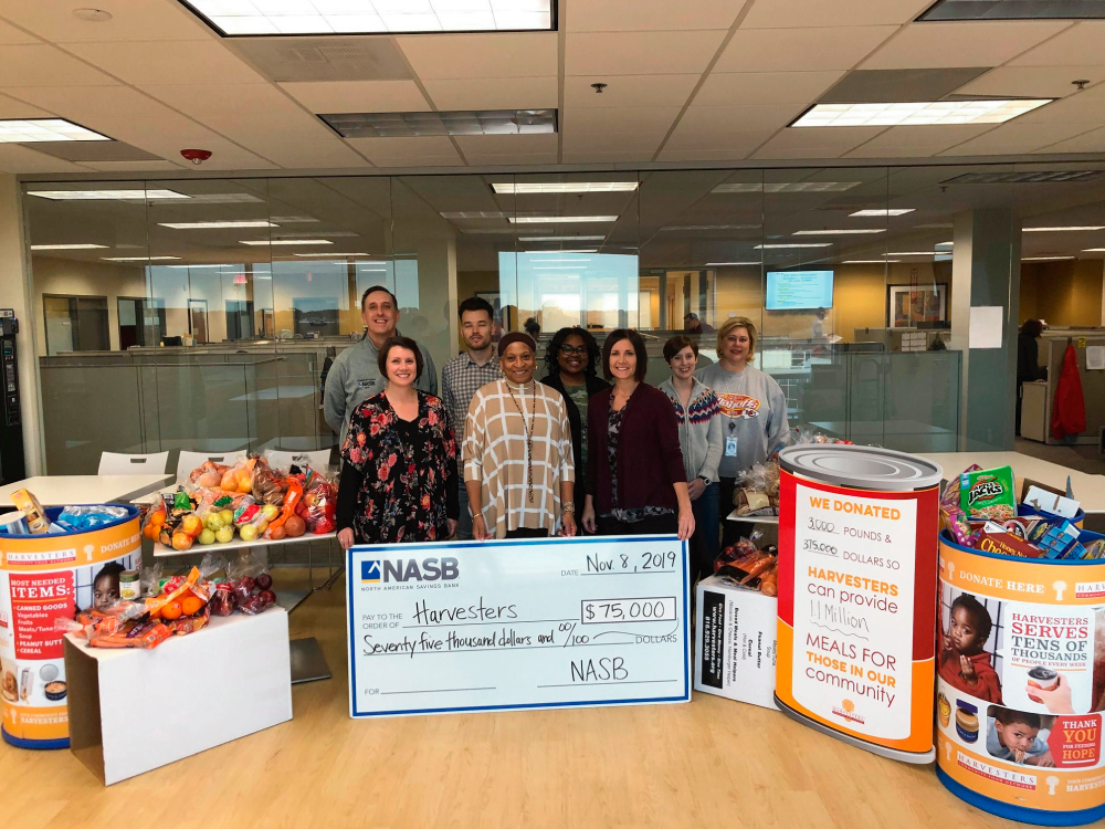 Group Standing by Donations after Food Drive