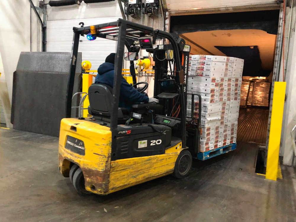Loading Pallet of Food on Truck