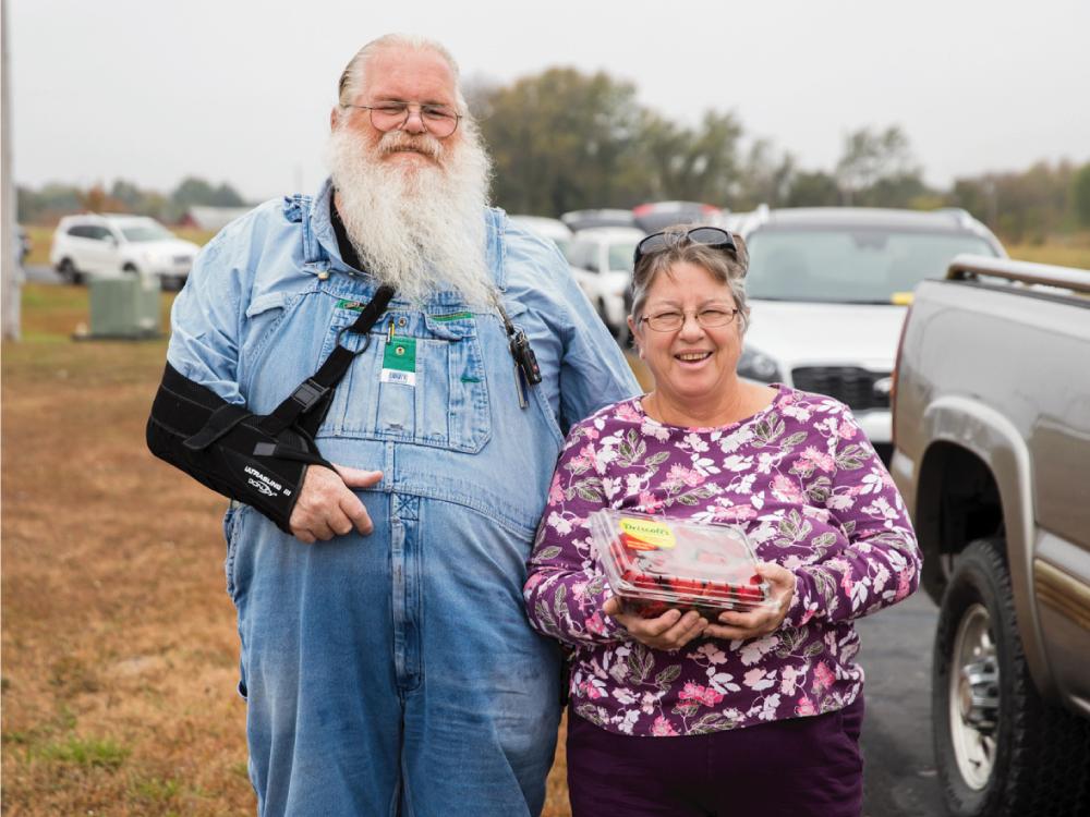 Senior Couple Holding Strawberries