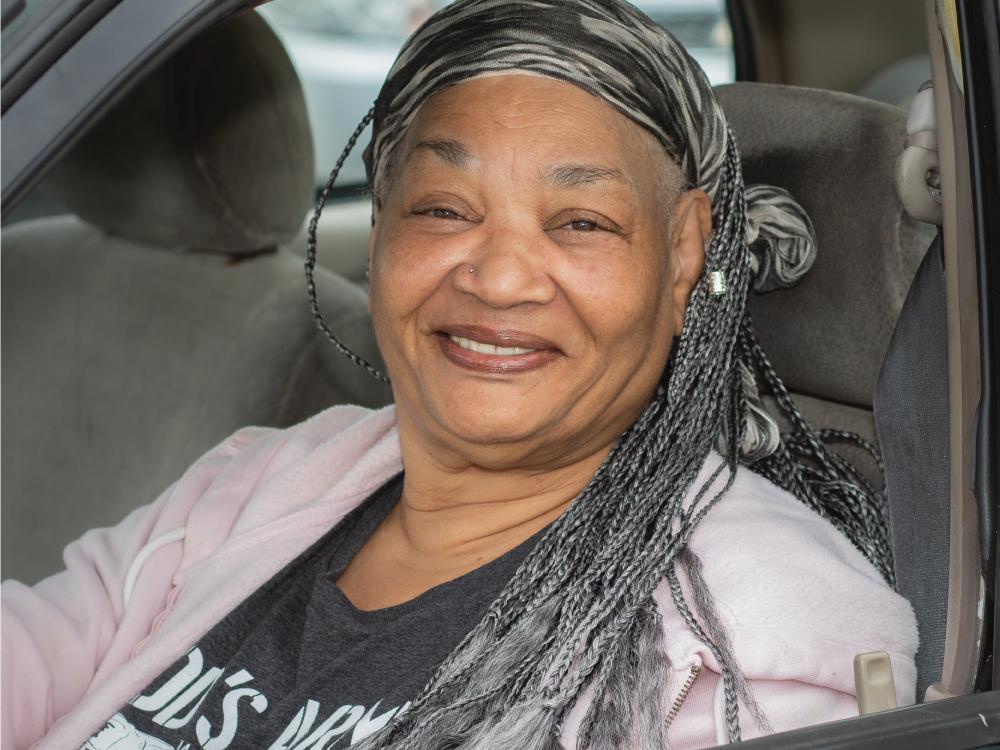 Senior Woman Sitting in Car