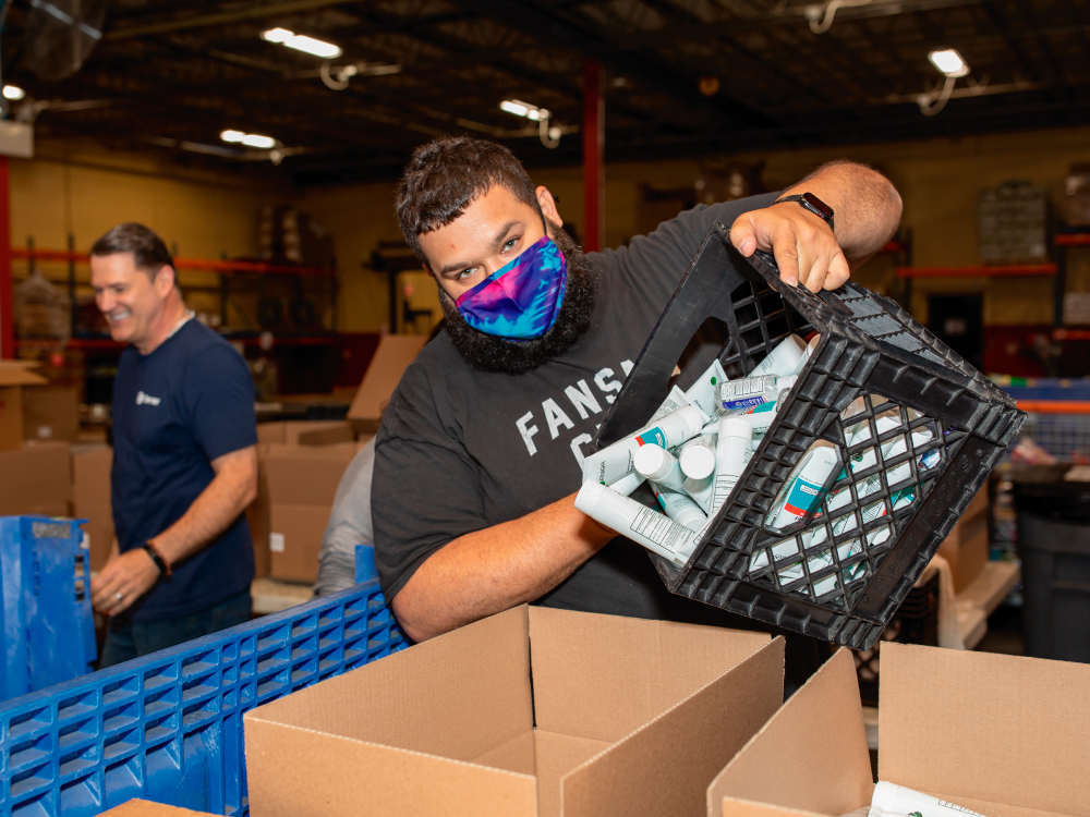 Man Pouring Hygiene Products in Box
