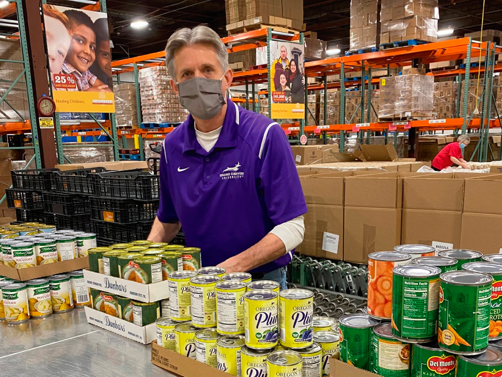 Man Packing Canned Food