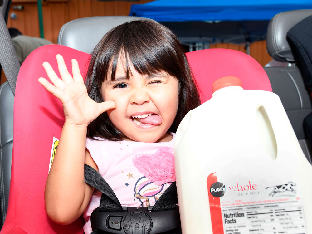 Young Girl Holding Milk